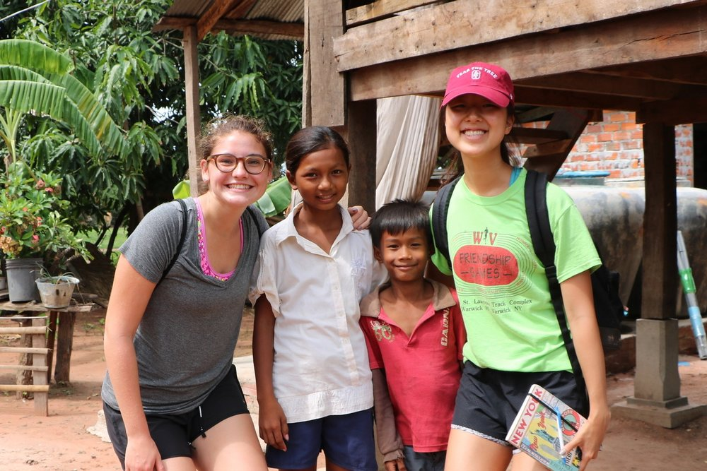 Alessandra (left) & Audrey (right) during a visit to the family home of their TASSEL student.