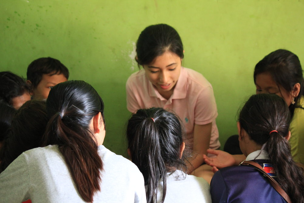 Maria with TASSEL students in Samrang village.
