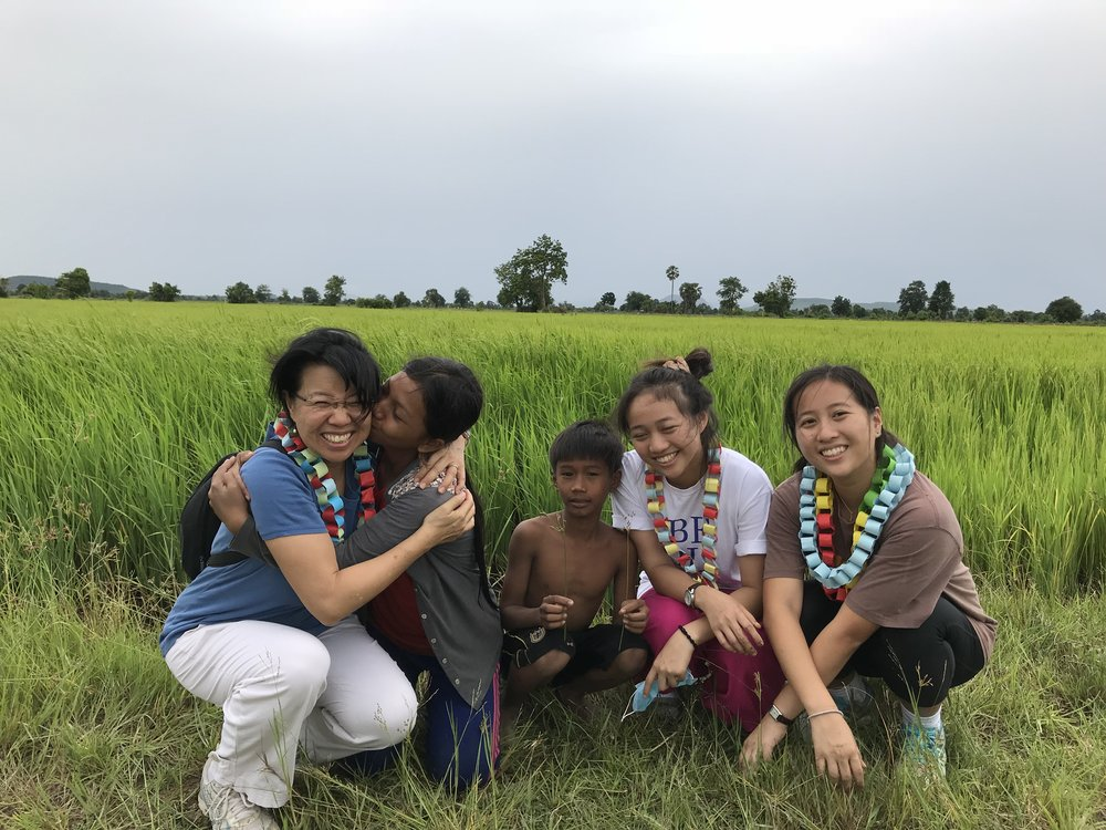 Doreen with her daughters and two TASSEL students. This is a rice field where the students scavenge for food like clams, tiny fish, frogs, etc.