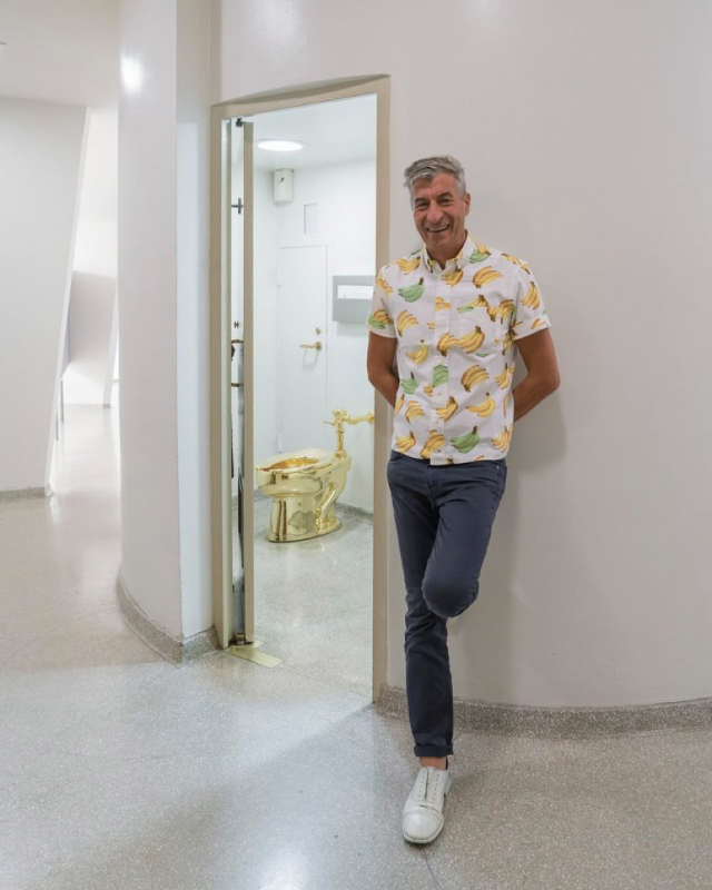 Maurizio Cattelan with his sculpture  America  t the Solomon R. Guggenheim Museum.
