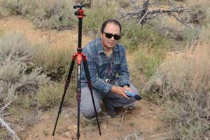 GIS Director, Emanuel Vasquez, taking acoustic data in sage-grouse habitat