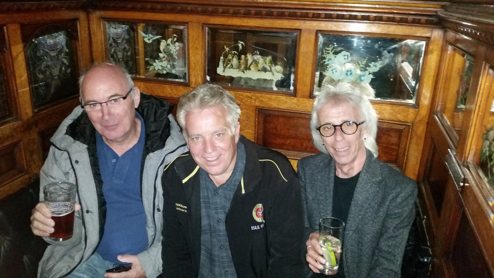 - It's not often that we get chance to relax with a night off while we are touring but here is one such occasion. Colin with Charlie and John enjoying a small libation at the famous Crown Liquor Saloon in Belfast.