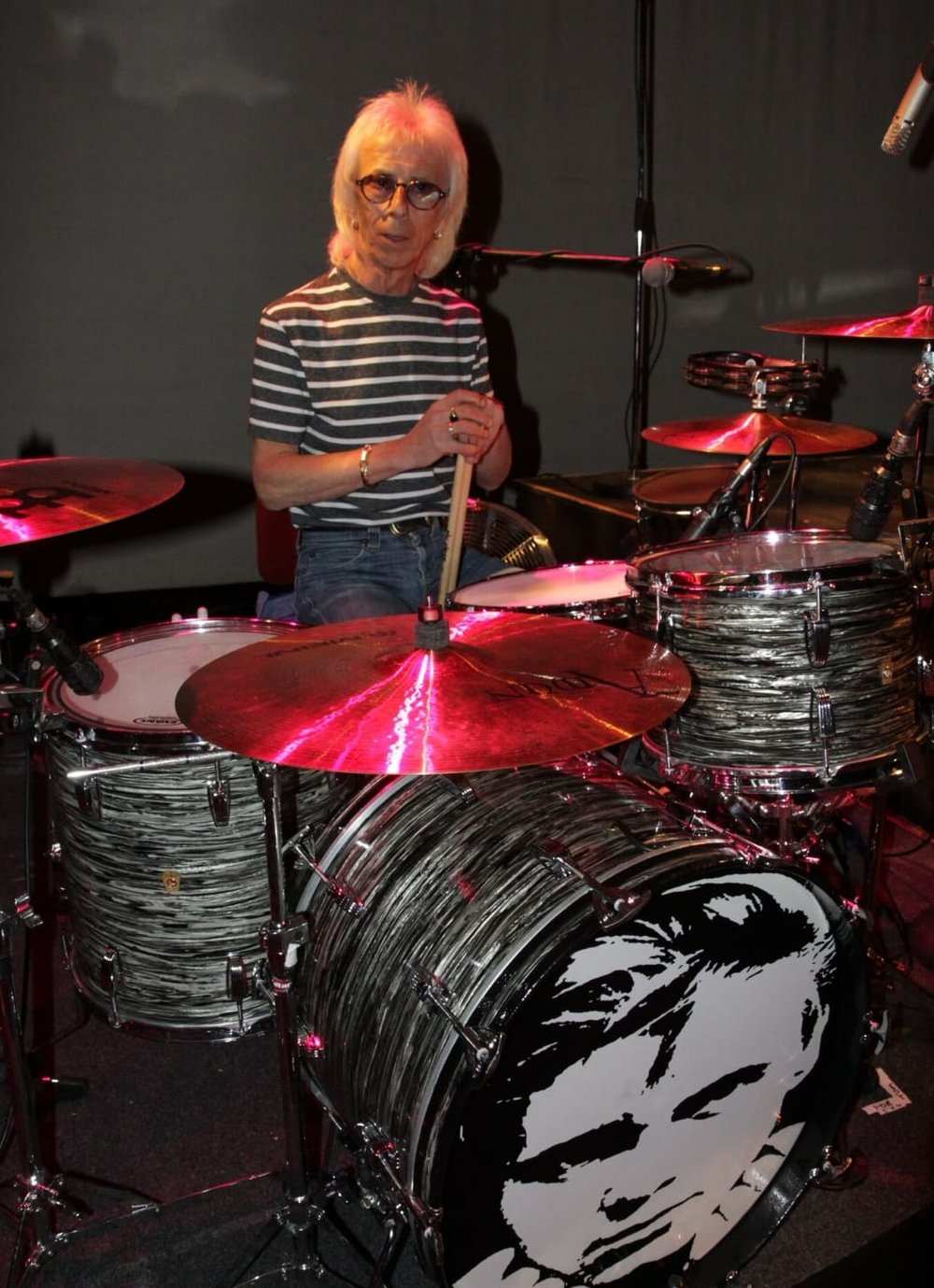- John has quite a collection of Ludwig Drum Kits.Here he is sat at his favoured 1964 Ludwig Black Oyster Super Classic.