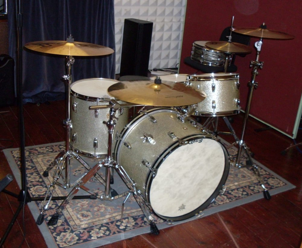 - John's 1965 Silver Glitter Ludwig Down Beat Kit which he used on the last CD.