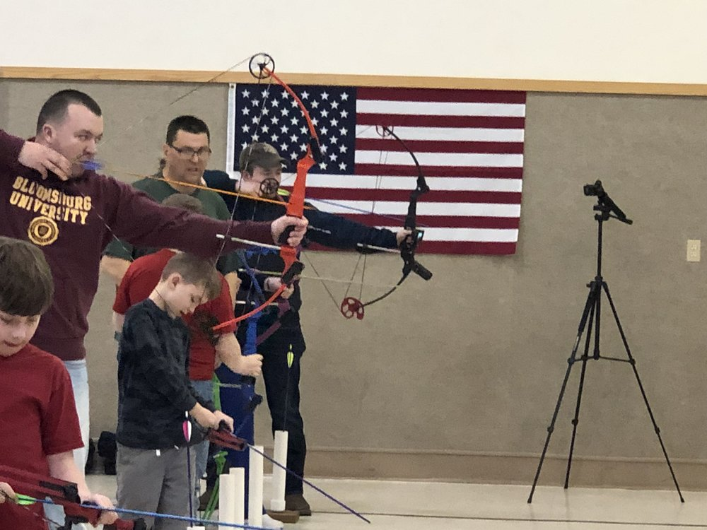Kids and adults shooting side by side!