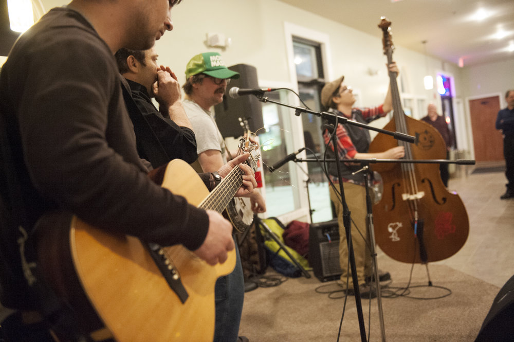 At open mic nights at  Serenity  (with Aaron Whited), musicians come together on stage, and play to the crowd. Here, members of the  Rescue Rangers  play alongside other local musicians throughout the night.