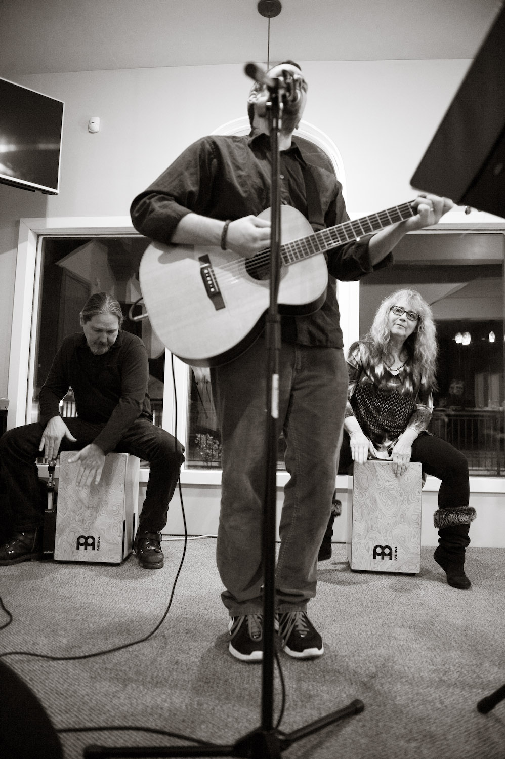 Aaron Whited,  Bruce Killen  and  Sherri Killen  performing together at Serenity Coffee House's open mic night, earlier this year.