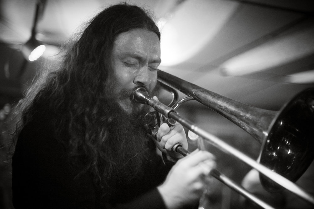 Robert Staggers Shank , Trombonist of  Qiet , and Trombonist/Mellophonist/Cornetist of  Beggar's Clan,  is performing with both bands this week in Charleston. This photo, from the Qiet Mountain Stage Performance after party, is by  Michelle Waters.