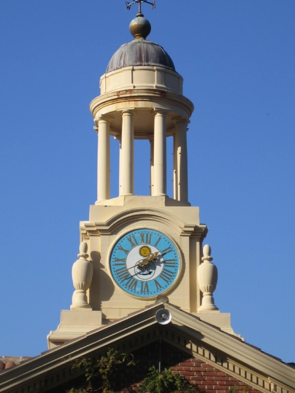 The clock with its Doric column dome.