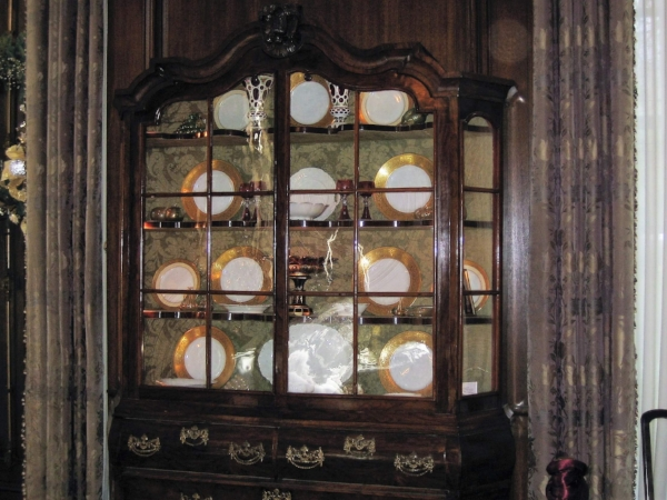 Antique China cabinet with very ornate escutcheon plates. Love the gold and white china, it looks like a Haviland pattern.
