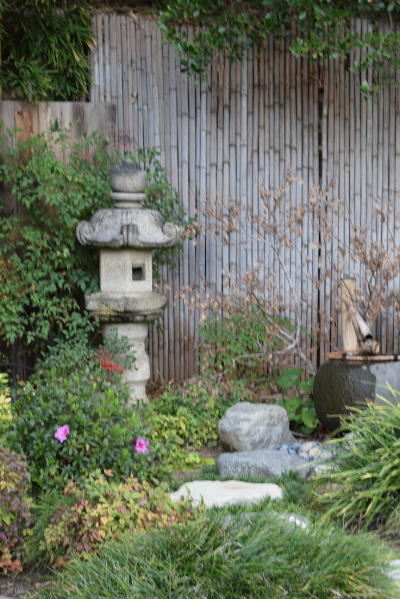 Small garden fountain and statue.