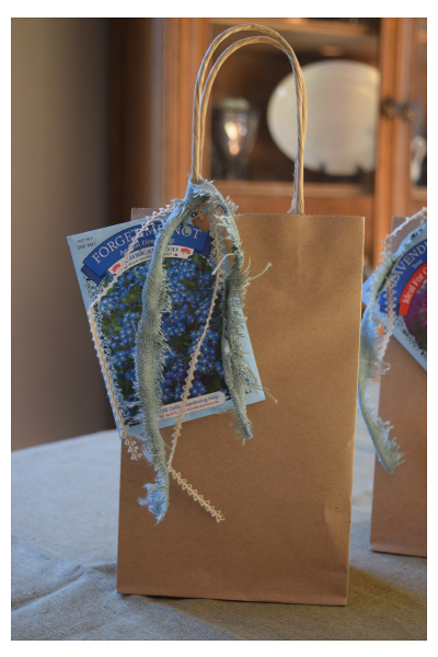 The goody bags with forget me not seed packets.