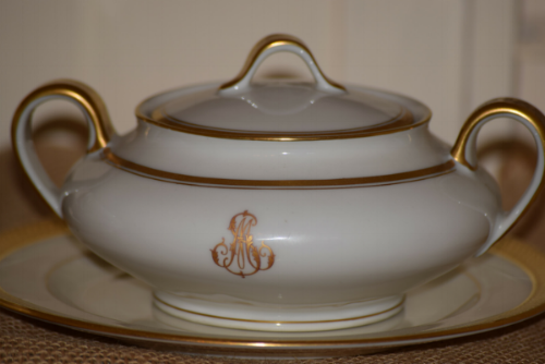 An antique Haviland monogrammed lidded bowl found at a thrift store lends it's beauty to this table setting.