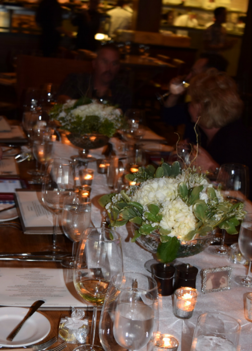 Here is a picture of the table length view. The white silk table runners, mercury glass candles, and flower arrangements looked beautiful on the antique stained wood dining tables.  I
