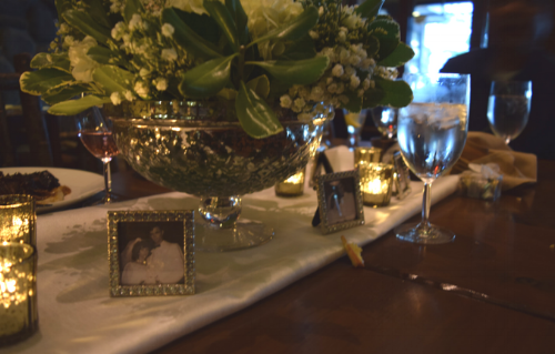 A close up of the rhinestone frames, mercury candles,and hydrangea with roses white flower arrangements. This picture really shows the beautiful ambiance created by the candles and the reflection of the silver glass. Just out the windows was a beautiful view of Lake Tahoe with the sun just beginning to set.