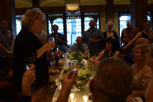 The maid of honor giving a champagne toast.