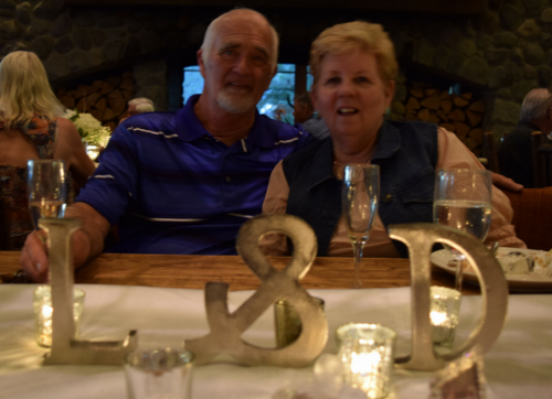 My parents sitting at their place in the middle of the tables.