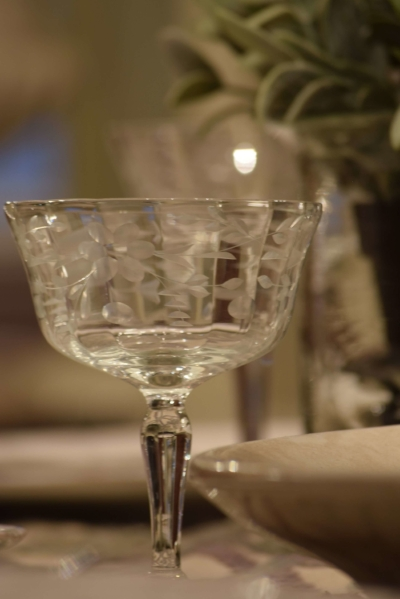 Antique etched stemware add a delicate touch to this table setting.