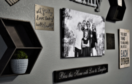 Black and white photo printed on canvas anchors this wall display.