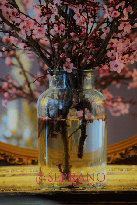 Pink Flowering Plum Tree Blossoms in an antique pickle jar vase.