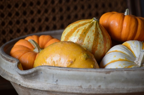 Add a group of mini pumpkins and gourds to your favorite ceramic bowl for an instant fall table centerpiece.