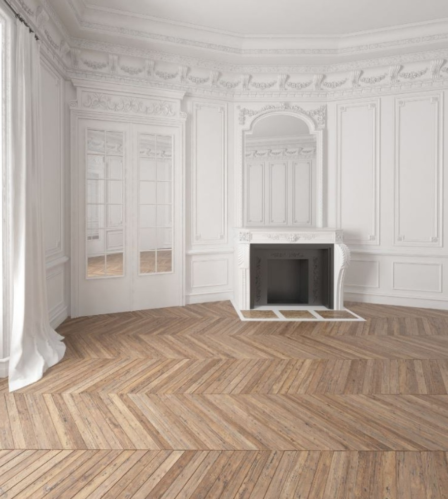 Herringbone wood flooring pattern in this French living room.