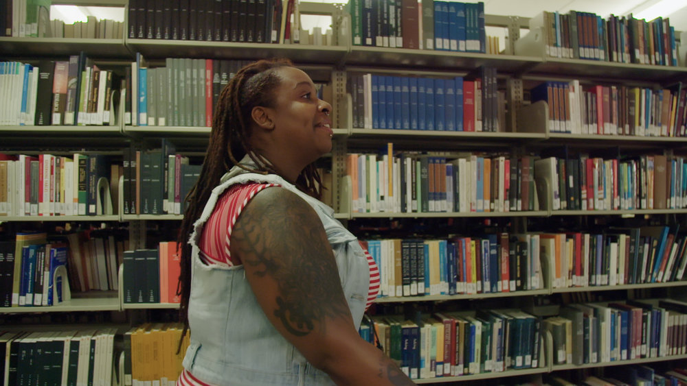 Shalita Williams in library.jpg