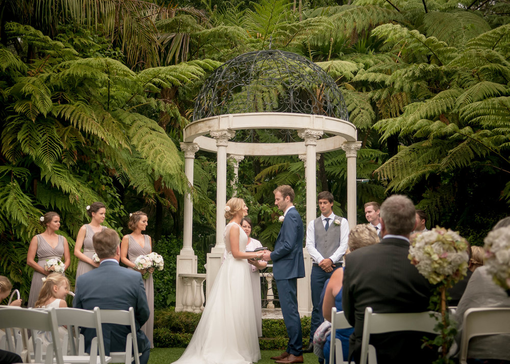 Outdoor wedding ceremony with couple taking their vows