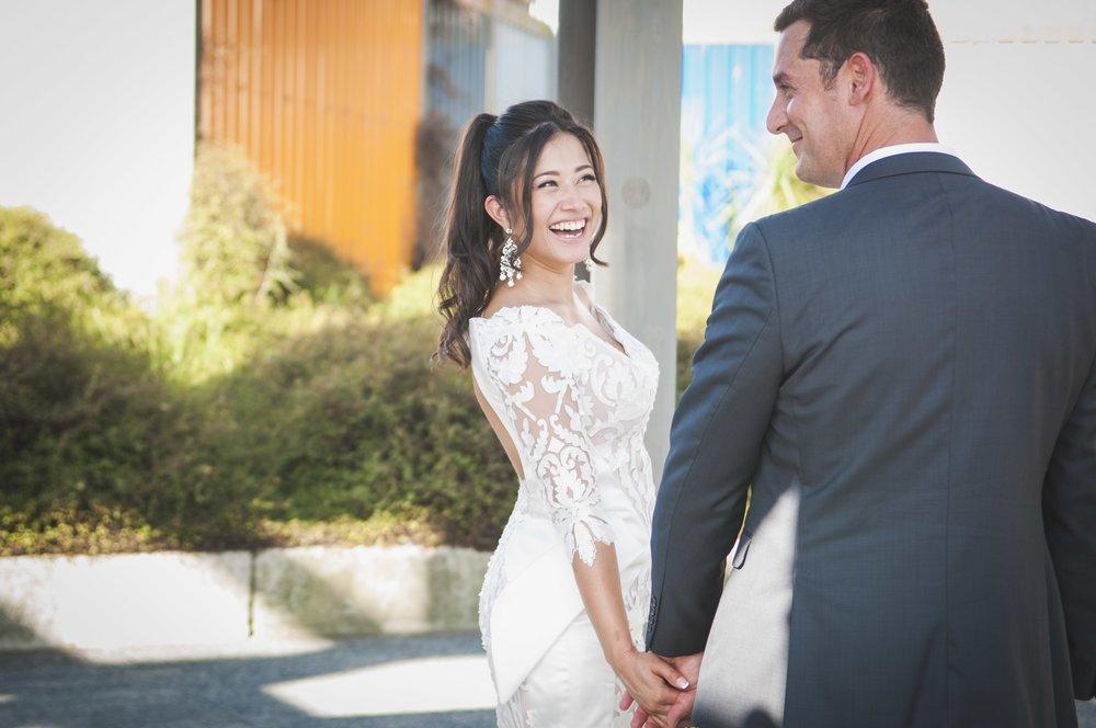 bride-and-groom-walking-laughing-natural.jpg