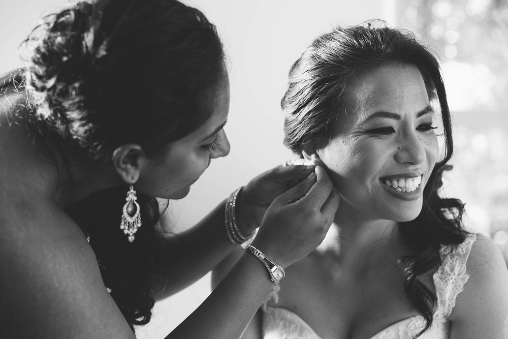 Laughing Bride Getting Ready