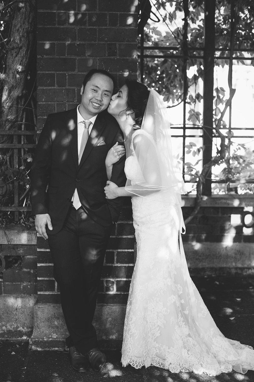 Bride kissing Groom black and white