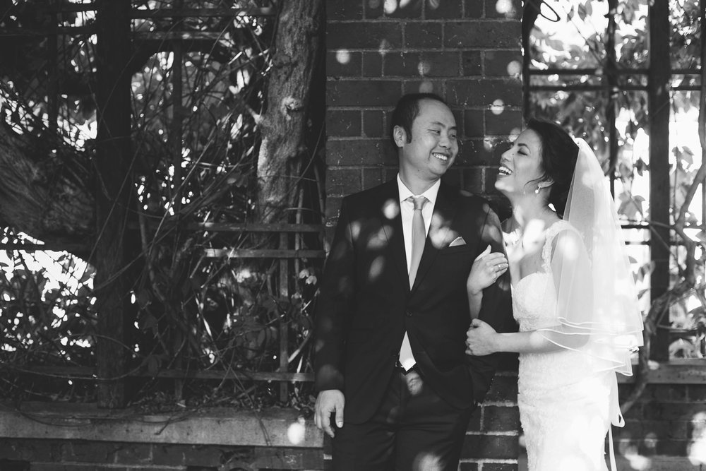Bride and Groom laughing black and white