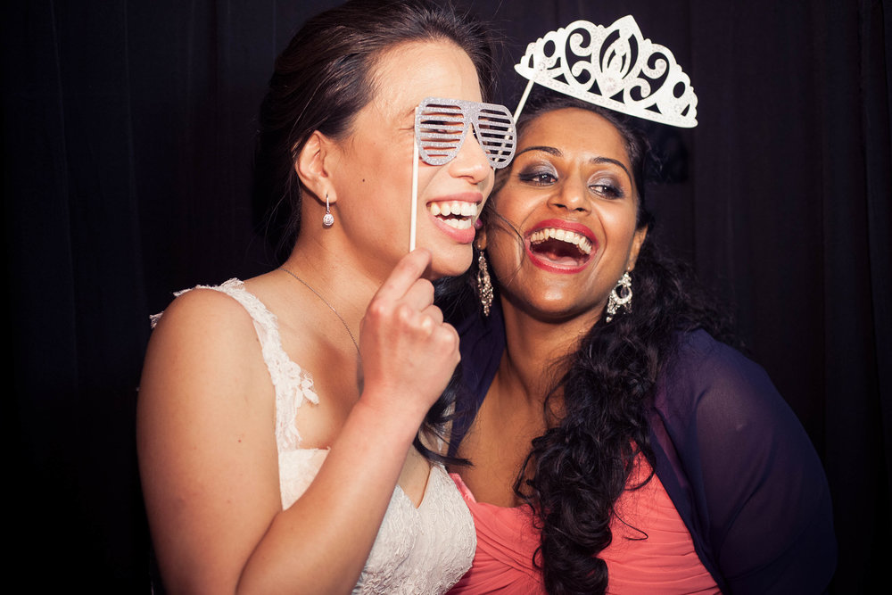 Bride and Bridesmaid in Photobooth