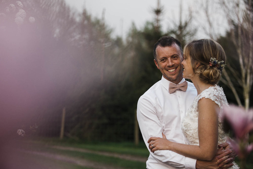 Bride and groom smiling during wedding photography shoot