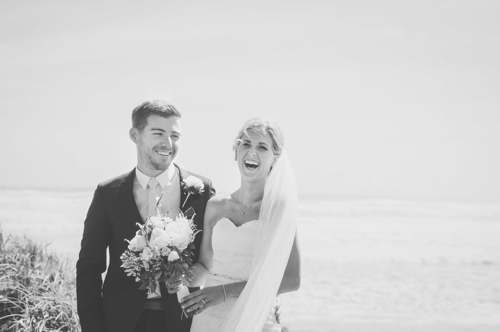 Portrait of wedding couple laughing at outdoor wedding