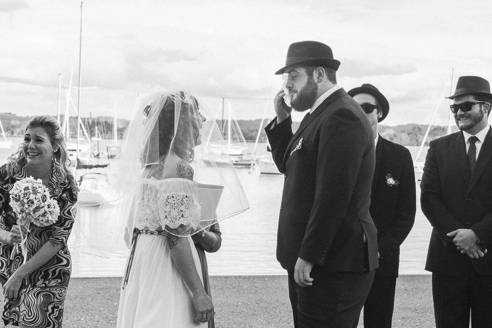 groom-at-ceremony-beach-wedding.jpg