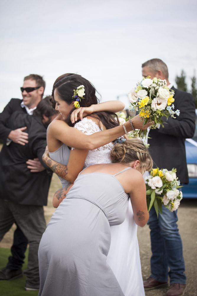 bridesmaids-hugging-bride