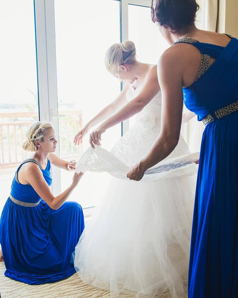 Capturing the natural light as the bride gets ready for her big day with help from her bridesmaids