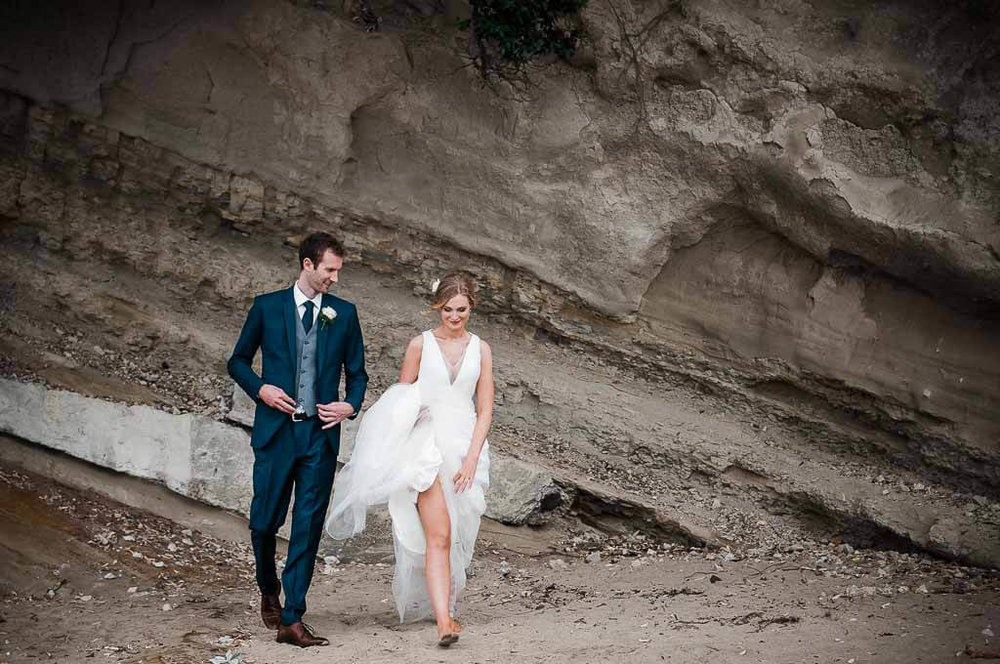 A special moment caught on camera with this wonderful couple as she walks barefoot across the beach