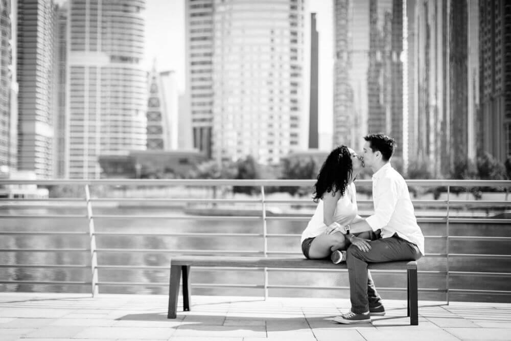 couple-kissin-on-bench.jpg