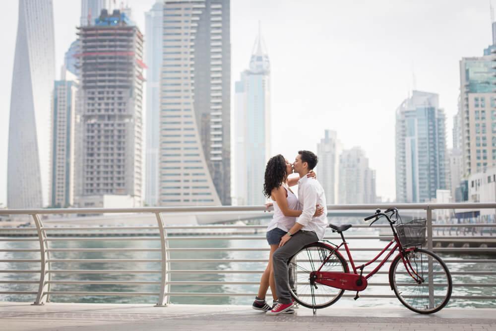 couple-kissing-on-bike-engagement-photography.jpg