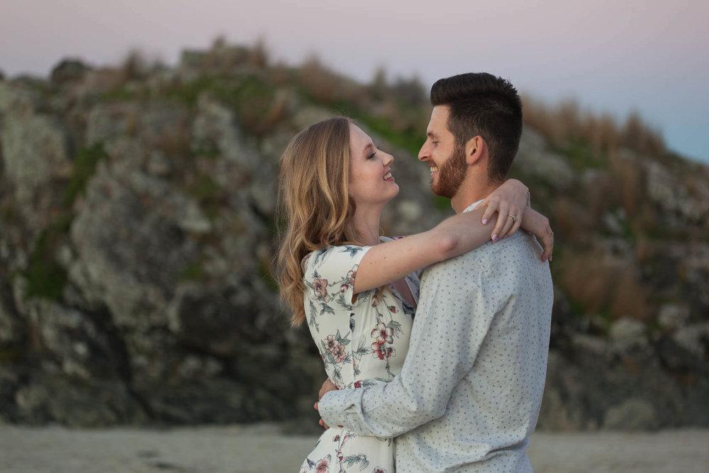 couple-smiling-on-beach.jpg