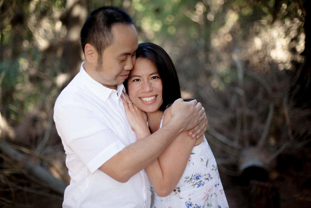 couple-smiling-and-hugging.jpg