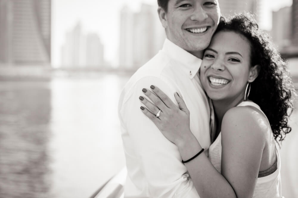 engaged-couple-smiling-and-laughing.jpg