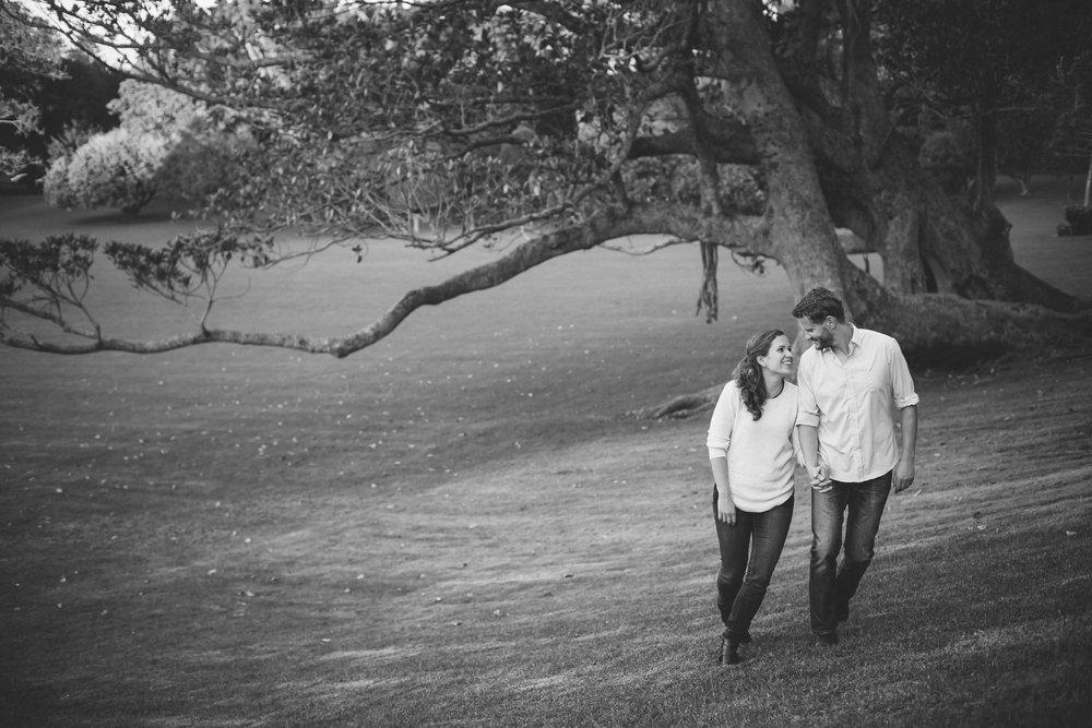 newly-engaged-walking-through-park.jpg