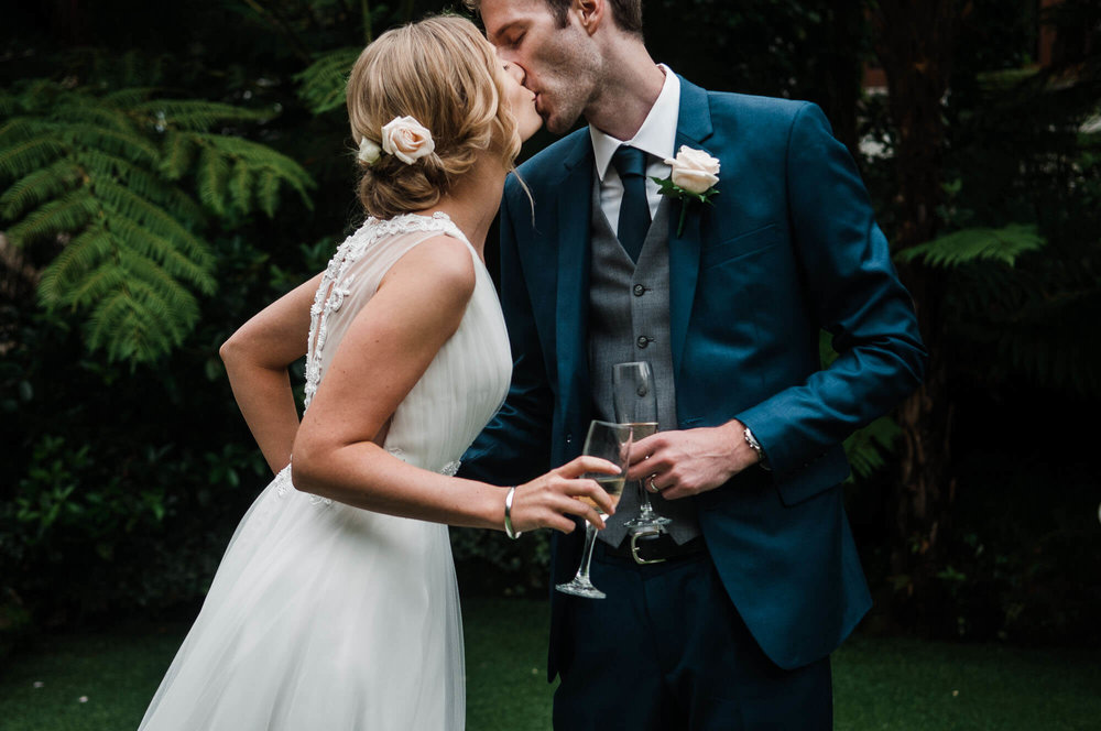 bride-and-groom-kissing-with-champagne.jpg