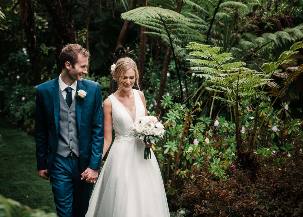 bride-and-groom-walking-through-forest.jpg