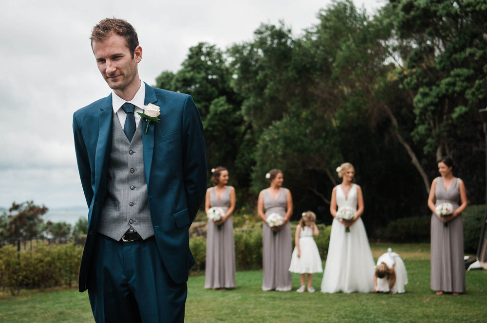 groom-in-foreground-waiting-for-first-look.jpg