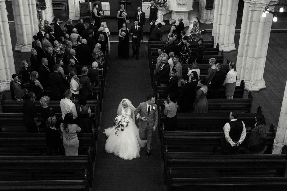 bride-and-groom-walking-down-aisle.jpg