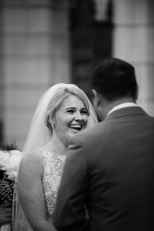 bride-laughing-at-altar.jpg